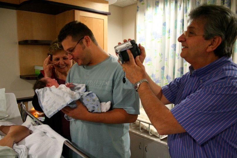 I have always loved this photo... taken when Nick's family met Joah for the first time: the first Costaras boy! Joah's uncle Dino is holding him... while Nick's dad films and Nick's mom grins from ear to ear...