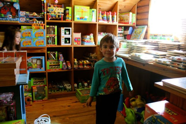 Joah exploring all the wonderful wooden toys & games...
