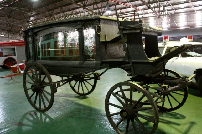An eerie funeral carriage complete with coffin...