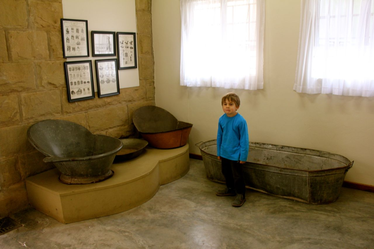 Joah wasn't sure what to make of these old baths (displayed in the loo foyer at the JP Nel Museum)...