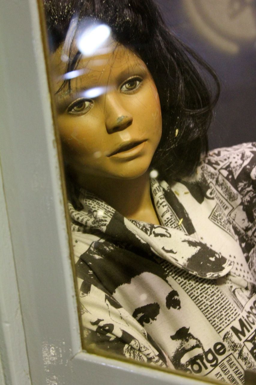 """I am assuming... based on mannequin-daughter's """"WHAM"""" shirt... and mannequin-mother's shoulder pads... that these mannequins were positioned in the early 80's and haven't been touched since..."""