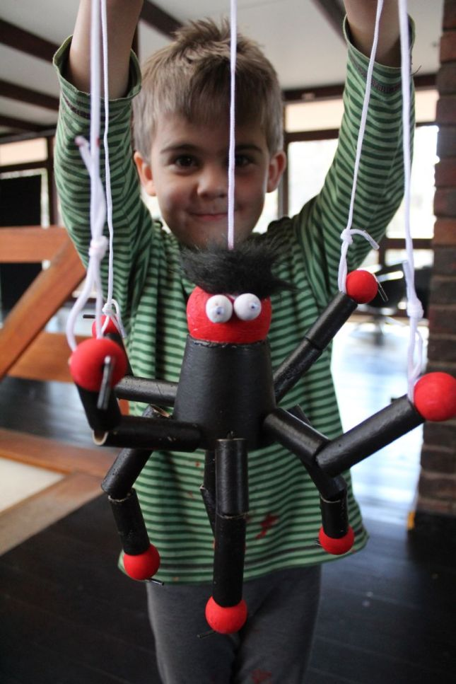 Joah with his puppet spider...