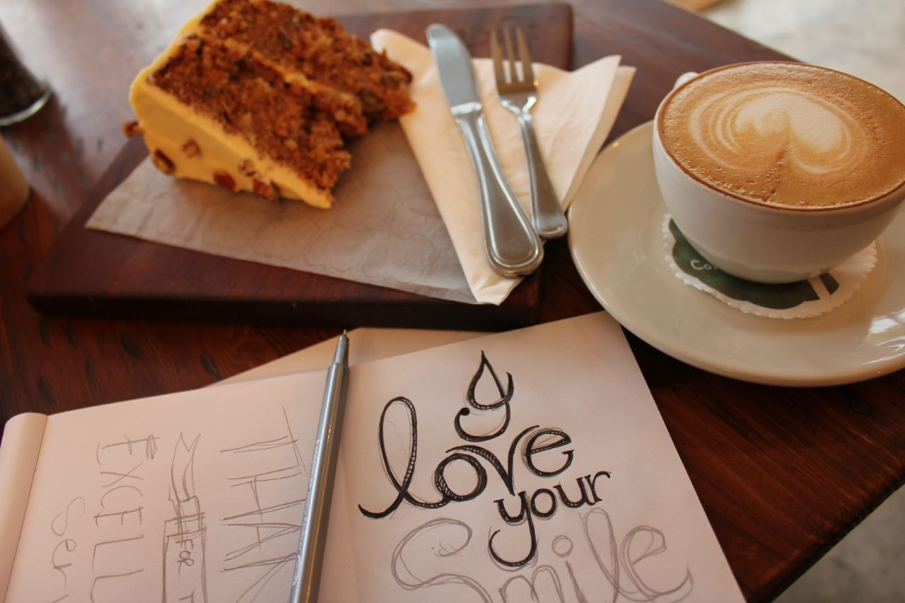Drawing at coffee shops... with a regular supply of coffee - and a slice of moist carrot cake!
