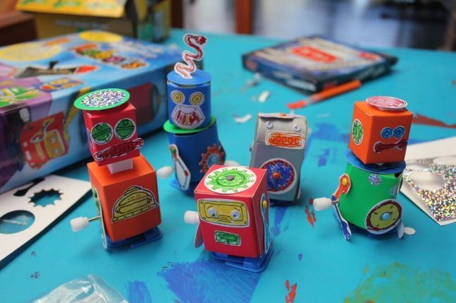 The 5 finished robots. They're wind-up robots, so they walk. It's very cute to watch...