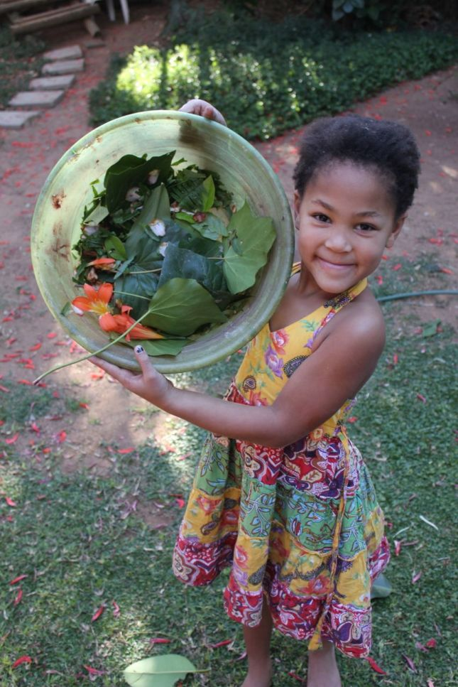 "This is Zahra - Morgan and Joah's friend from next door with the ""salad"" that the 3 of them made (they invented a game around this salad which kept them busy for hours)..."