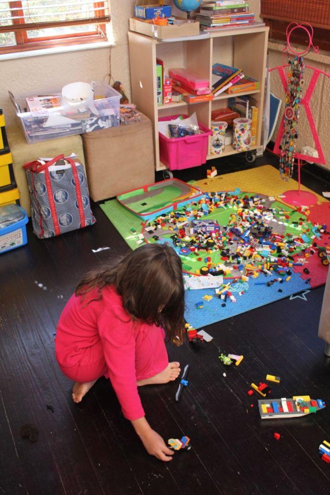 Morgan in her jammies... creating lego wonders...