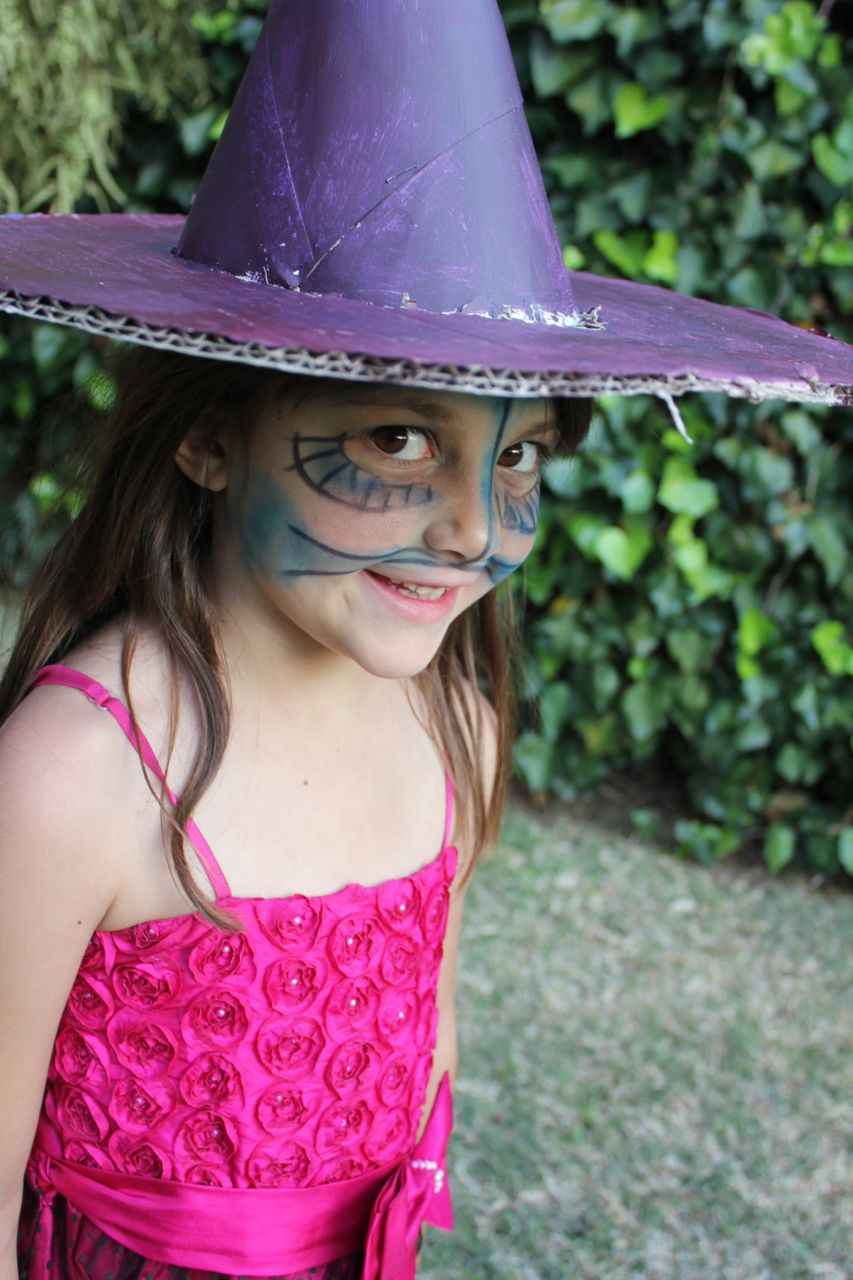 """Morgan is very jealous of American kids who get to go """"Trick or Treating"""" (which is not a big 'thing' here in South Africa). She decided to make herself a """"witch hat""""... I think it's pretty impressive!"""