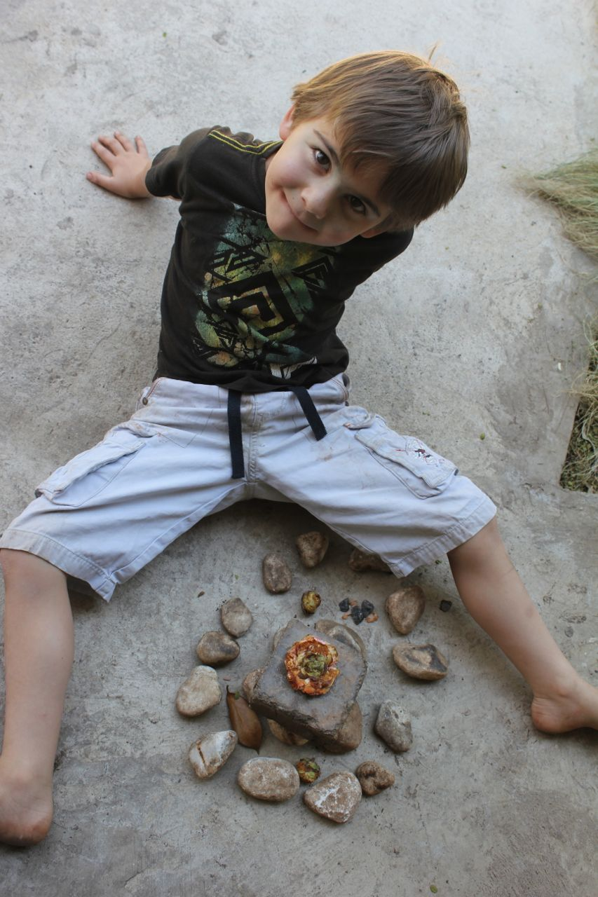 Joah building a creation out of rocks, and other bits and pieces collected from the ground (at a nursery)...