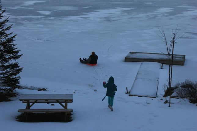 Nick & Joah sledding from the hill on to the frozen lake… with Morgan in hot pursuit...