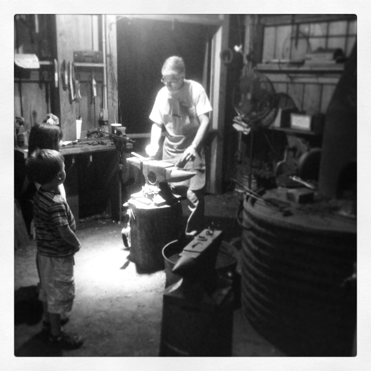 The blacksmith giving lessons to the kids...