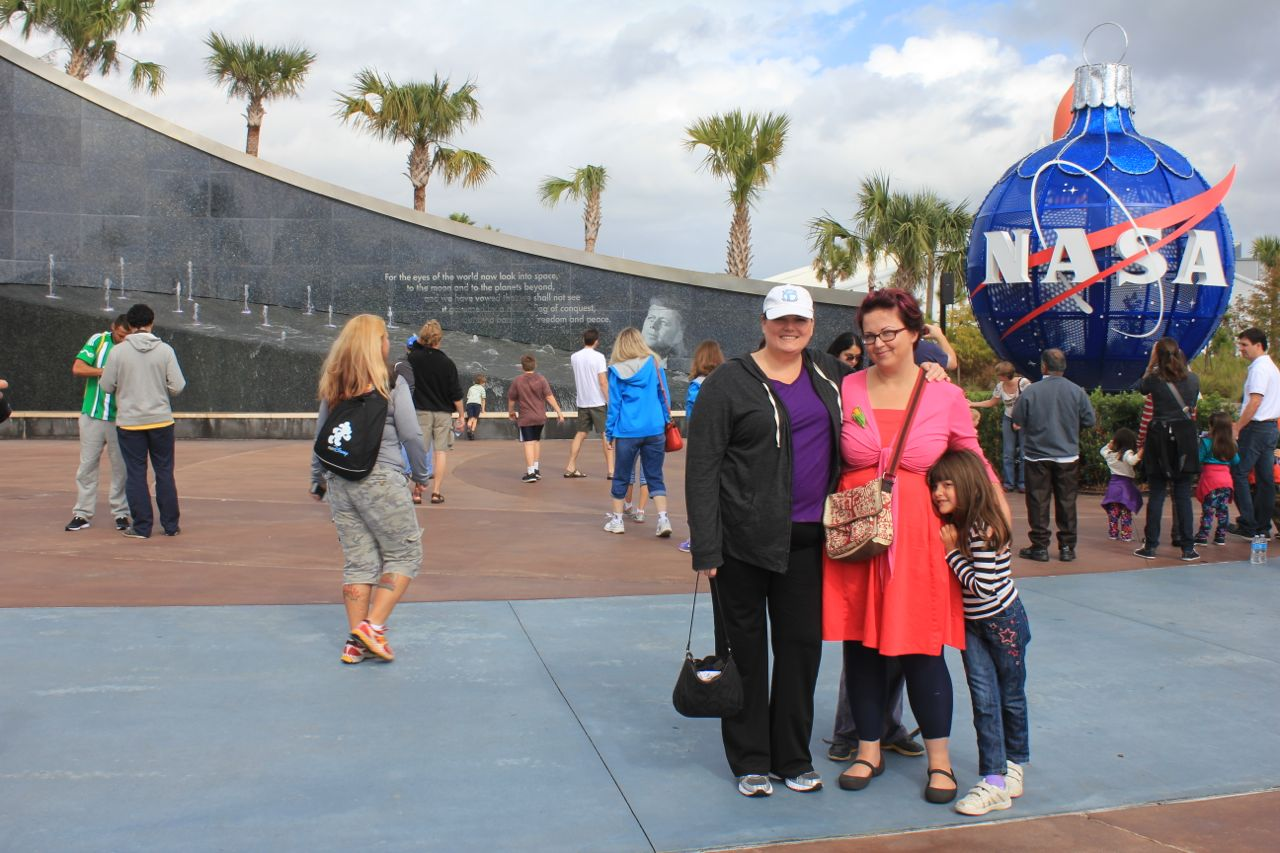 With Theresa (who got us great discounts on our tickets because she's a Brevard County resident)… at the entrance to the Kennedy Space Centre.