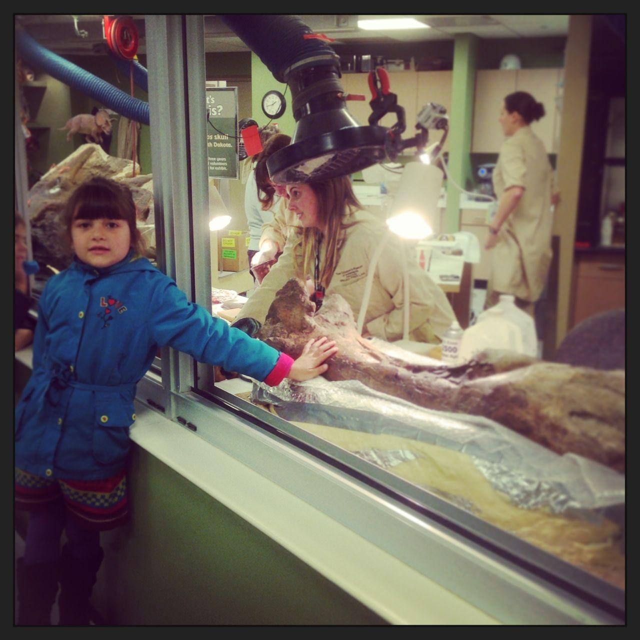 Morgan touching a fossilised T-Rex bone...