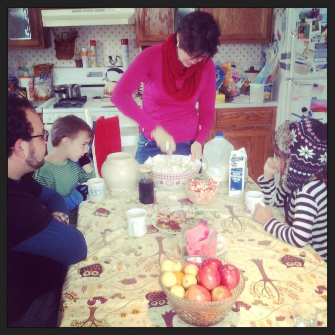Jenn making snow ice-cream while the kids look on...