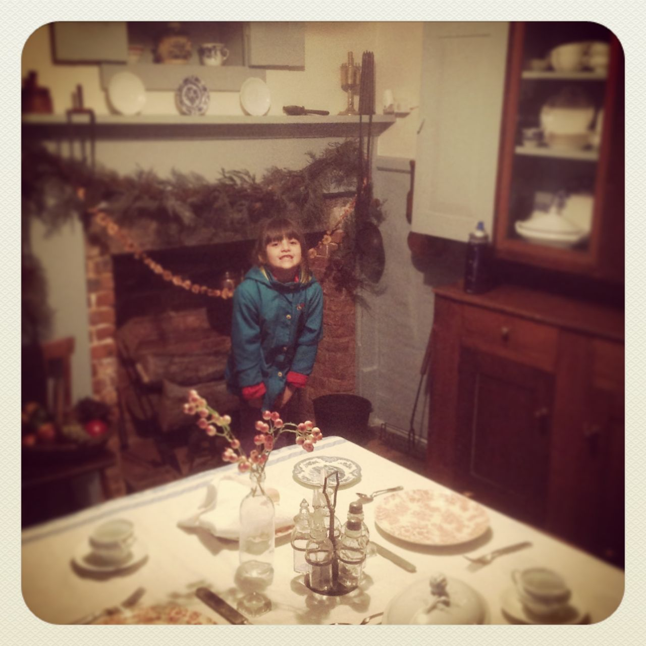 Morgan standing in Edison's old kitchen...