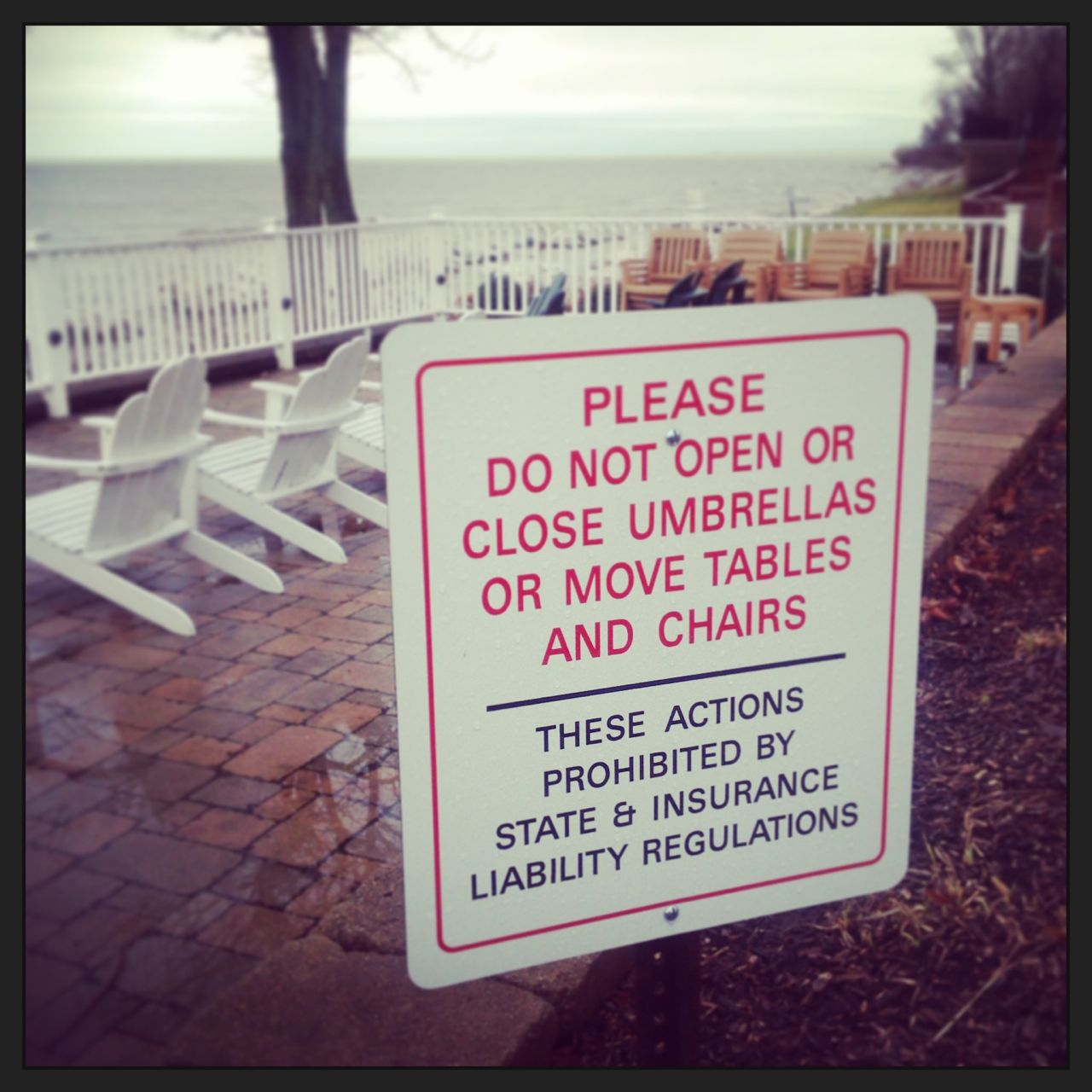 We took this photo in Geneva… and I find it a bit tough to believe. Seriously? It's illegal to move chairs or close umbrellas?