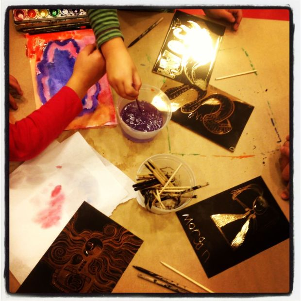 Painting and scratching designs into foil at the Walters Art Museum in Baltimore...