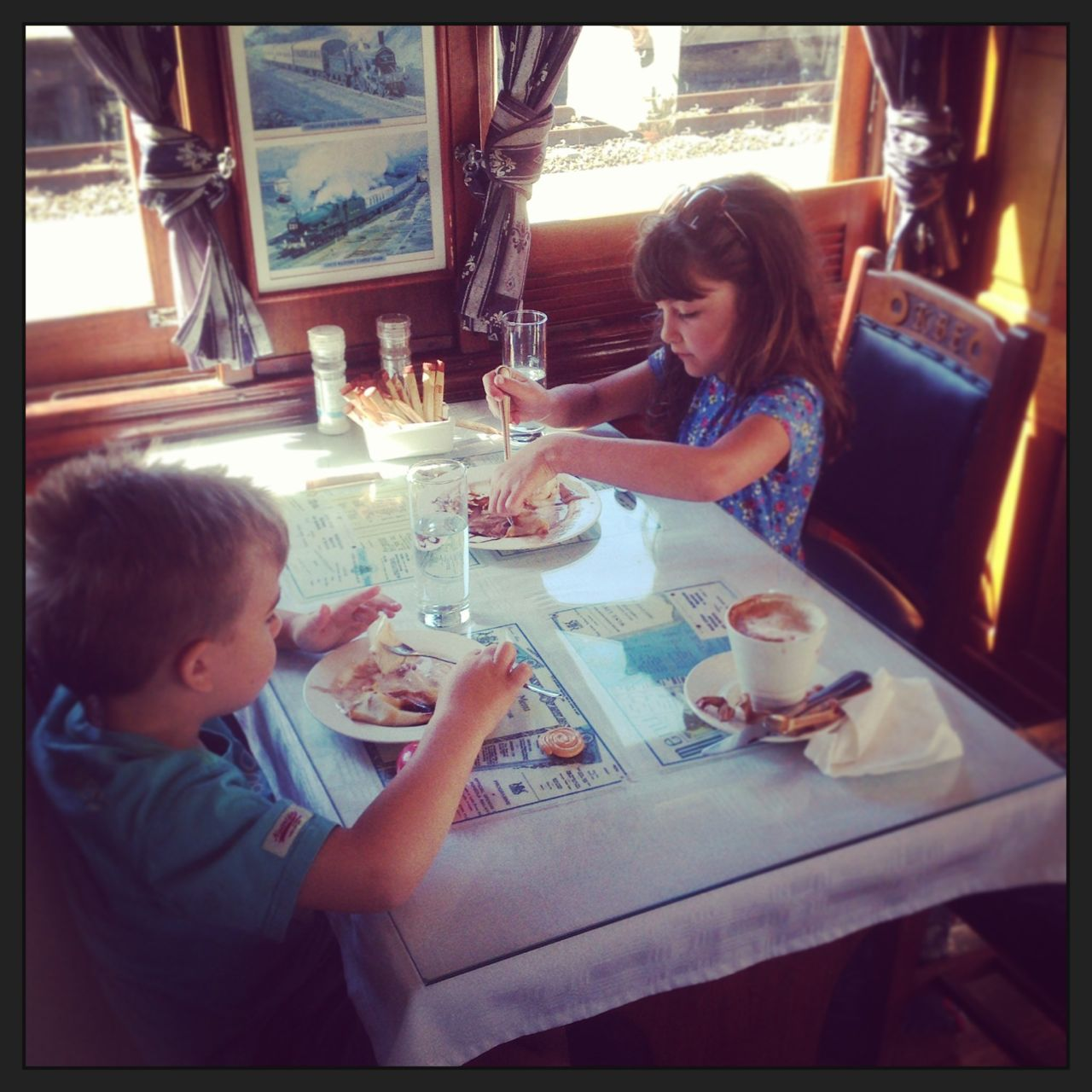 Enjoying pancakes in an old train (converted into a coffee shop) in Kalk Bay...