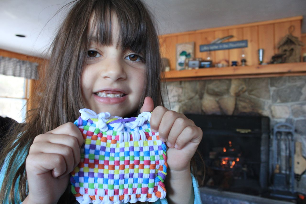 Morgan proudly displaying her woven coaster...