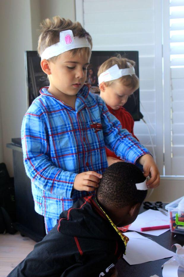 Joah… doing a hat fitting on Tyler...