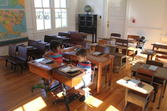 Our kids exploring an old school house at the Fort Christmas Museum in Florida...