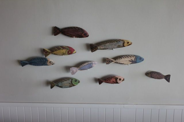 These fish are on the wall in our living area.  Can you guess why I like this little arrangement so much?