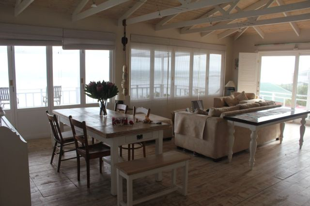 The lounge / dining area… with windows leading out on to the deck… all with uninterrupted views of the sea.