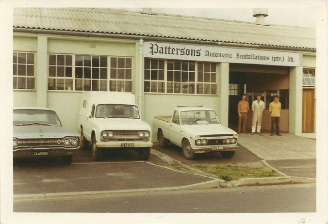Dad (white overalls in the centre) with his brothers, Mike and John… at the family business (before Dad left to start a business of his own)...