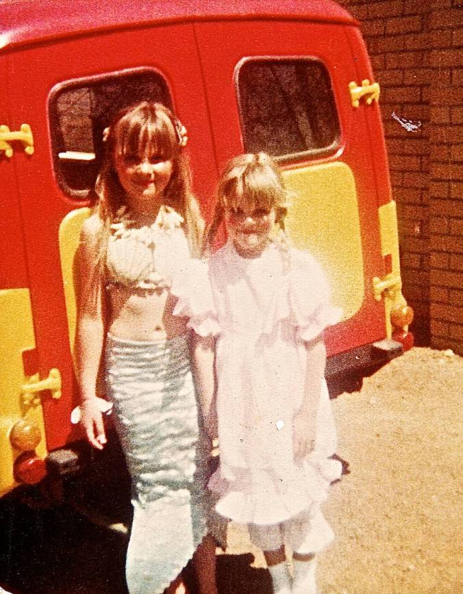 Soo and I as kids.  I'm the mermaid.  Who'd have thought that cute, pink little doll could be so fearless?